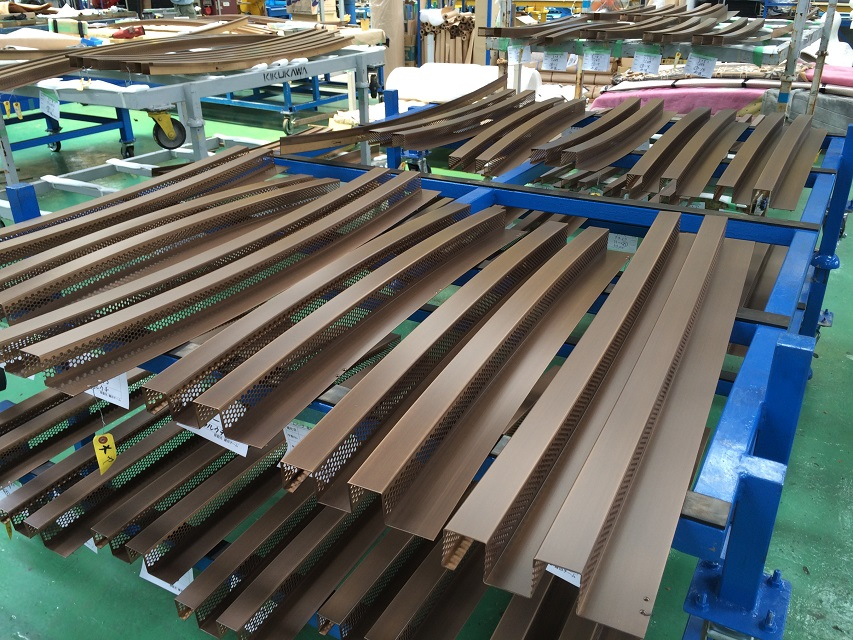 Rows of various R bent corrugated louvres