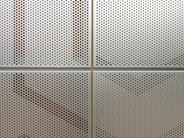 A designed perforation pattern, fabricated at Kikukawa