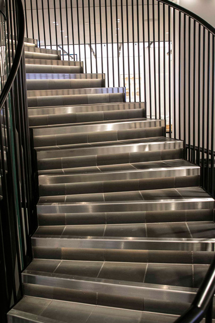Stairs and handrails lit up. The handrails are stylishly painted black with synthetic resin paint.