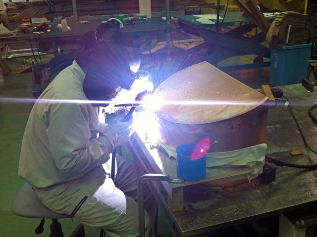 A Kikukawa craftsman carefully welding the copper pieces