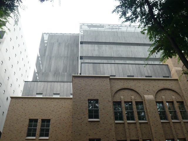The zinc phosphate coated steel panels are in harmony with the restored low-rise section of the building