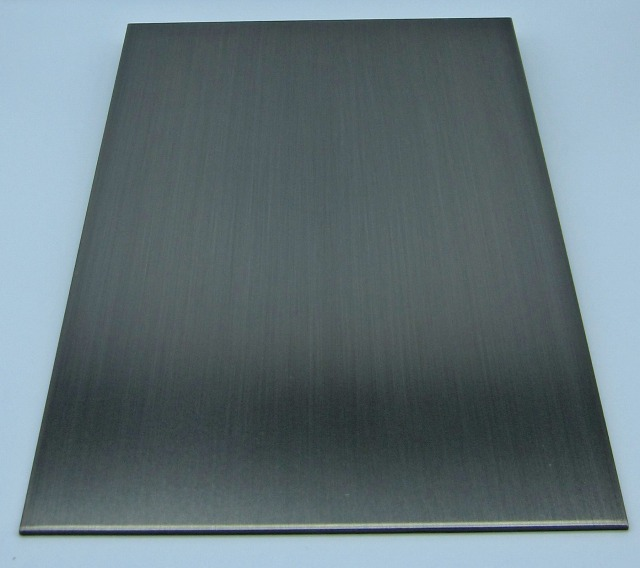 Sample of 'black nickel plated and hairline polished' stainless steel
