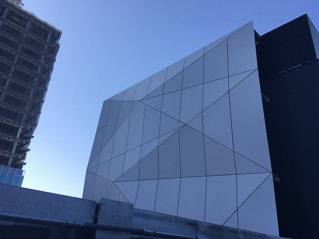 The peaks and valley of the Origami panels are more apparent from an angle
