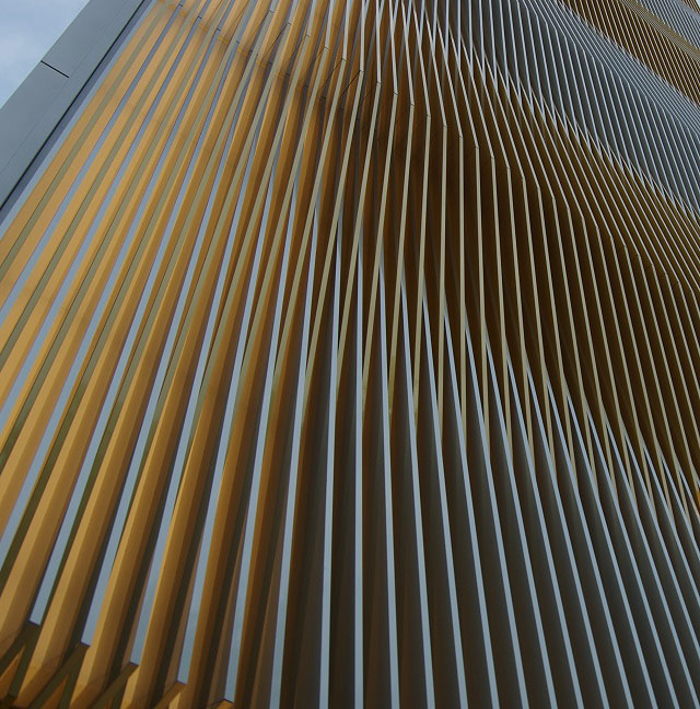 Louvres of alternating colour: silver anodization and gold dyed + anodized aluminium