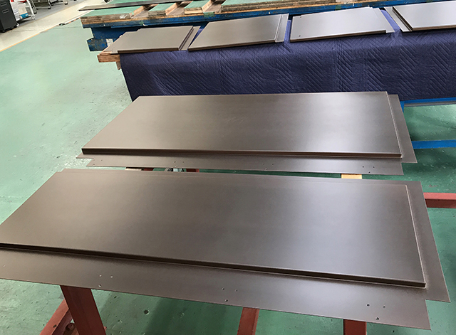 The fabrication of the 8 pieces of FURUMI (sulfurized) brass panels that composed the double doors