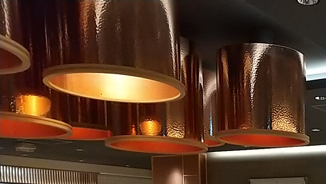 Glossy lampshades create a luxurious space