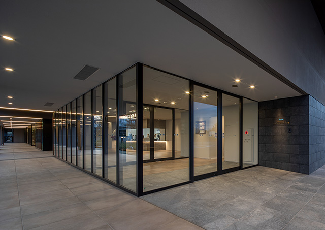 Front exit of the facility. The automatic door frames are also by Kikukawa.