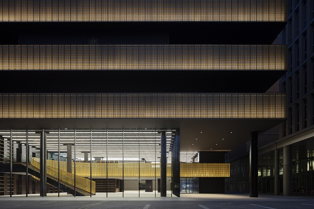 An illuminated Shippo (overlapping circles) patterned panel created with layered perforation (exterior screening and interior handrail panels)