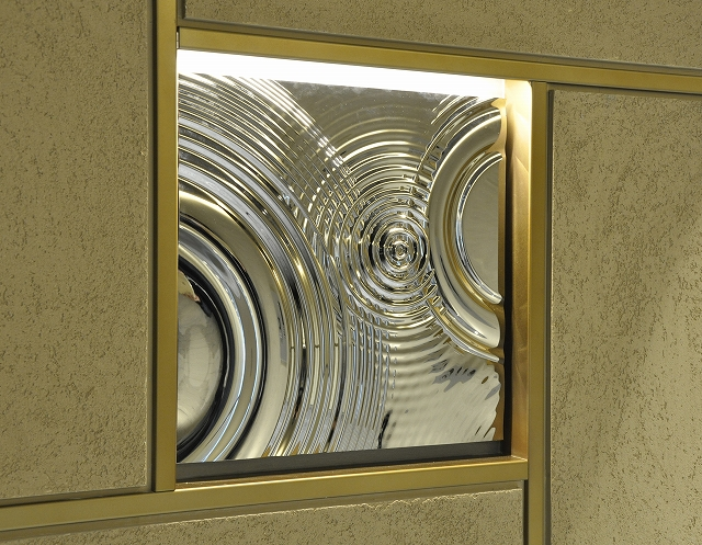 A metal relief panel installed in an apartment building entrance