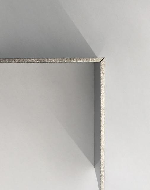 45度のテーパー切断を施した板材を突き合わせた写真。切断面がピッタリ合っており、品質の高さが伺える